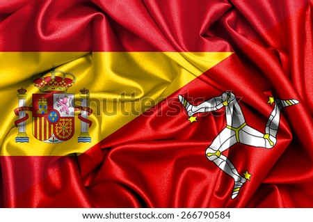 Waving flag of Isle of man and Spain - stock photo