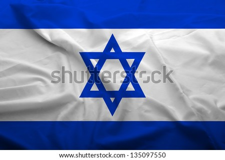 Waving flag of Israel. Flag has real fabric texture. - stock photo