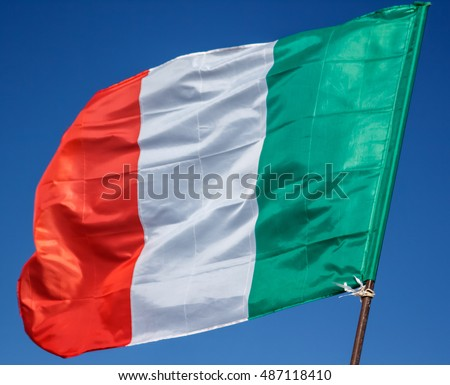 Waving Flag Of Italy, Europe, Italian Republic.Italian Flag Fluttering In The Wind, With Blue Sky. Green, White, Red And Azure Are Italian National Colors. Close Up Shot Of Wavy Italian Flag