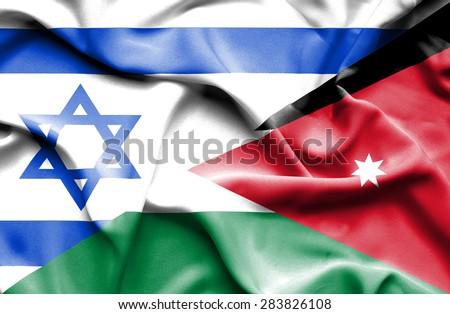 Waving flag of Jordan and Israel - stock photo