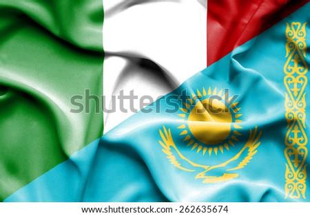 Waving flag of Kazakhstan and Italy - stock photo