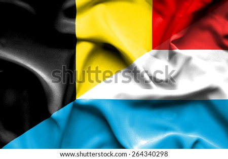 Waving flag of Luxembourg and Belgium - stock photo