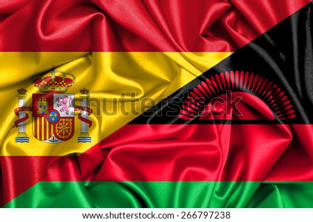 Waving flag of Malawi and Spain - stock photo