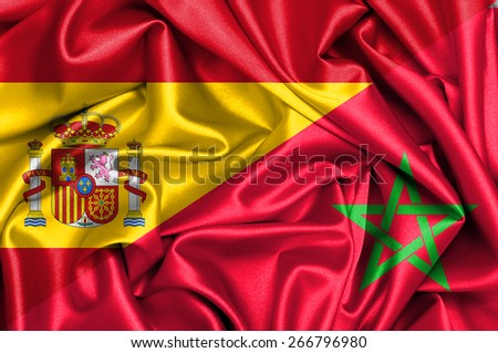 Waving flag of Morocco and Spain - stock photo