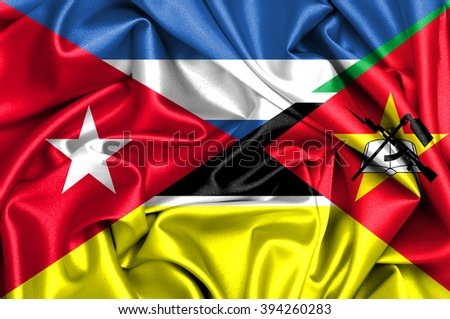 Waving flag of Mozambique and Cuba