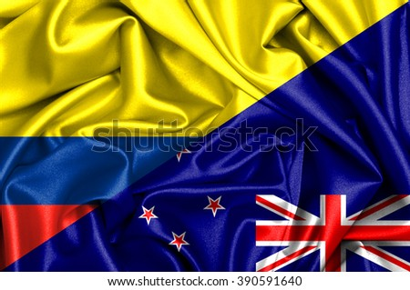 Waving flag of New Zealand and Colombia - stock photo