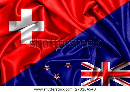 Waving flag of New Zealand and Switzerland