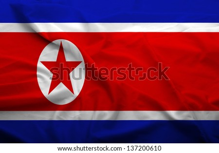 Waving flag of North Korea. Flag has real fabric texture.