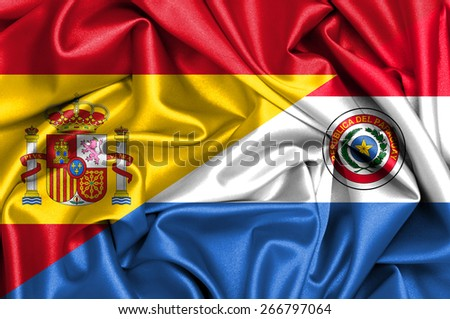 Waving flag of Paraguay and Spain - stock photo