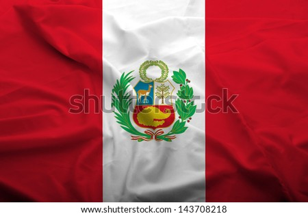 Waving flag of Peru. Flag has real fabric texture. - stock photo