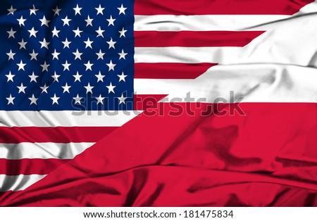 Waving flag of Poland and USA - stock photo
