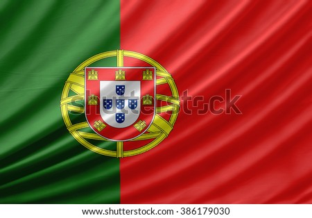 Waving flag of Portugal. Flag has real fabric texture - stock photo