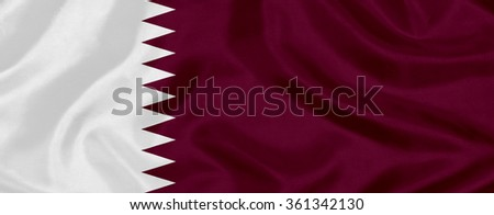 waving flag of Qatar on silk material - stock photo