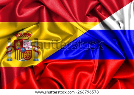 Waving flag of Russia and Spain - stock photo