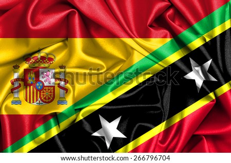 Waving flag of Saint Kitts and Nevis and Spain - stock photo