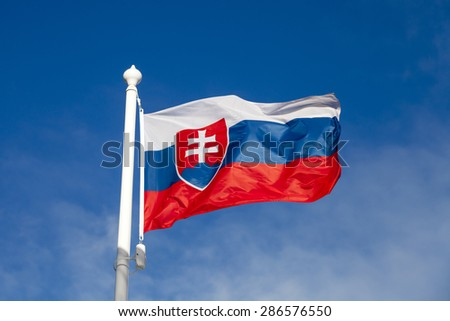 Waving flag of Slovakia against the blue sky - stock photo