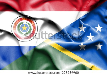 Waving flag of Solomon Islands and Paraguay