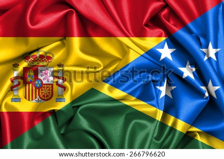 Waving flag of Solomon Islands and Spain - stock photo
