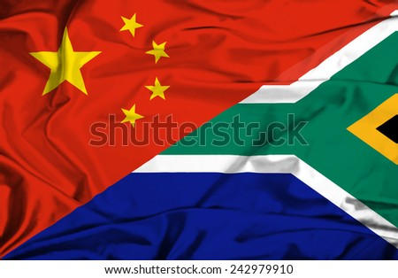 Waving flag of South Africa and China - stock photo