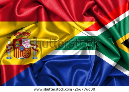 Waving flag of South Africa and Spain - stock photo