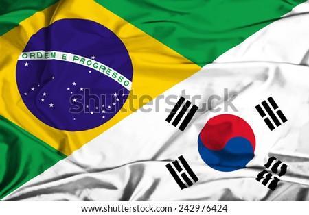 Waving flag of South Korea and Brazil - stock photo