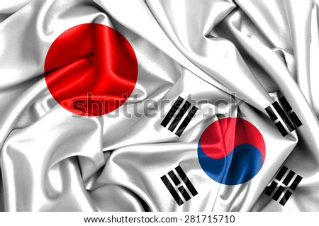 Waving flag of South Korea and Japan - stock photo