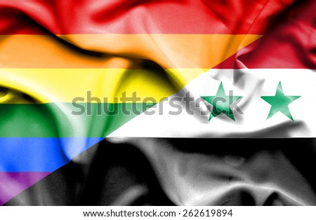 Waving flag of Syria and LGBT - stock photo
