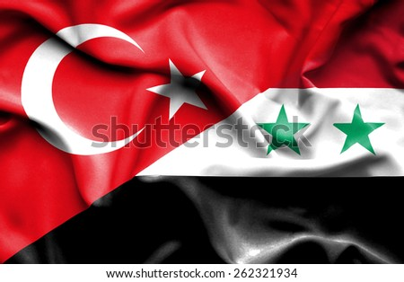 Waving flag of Syria and Turkey - stock photo