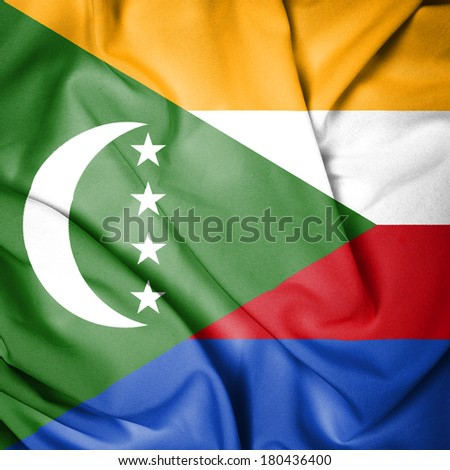 Waving Flag of the Comoros - stock photo