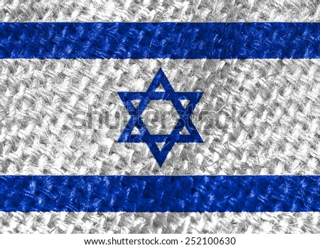 Waving flag of the Israel on burlap texture - stock photo