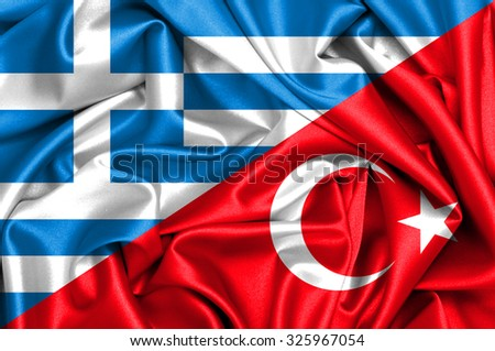 Waving flag of Turkey and Greece - stock photo