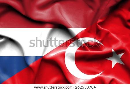 Waving flag of Turkey and Netherlands - stock photo