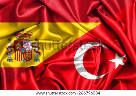 Waving flag of Turkey and Spain - stock photo