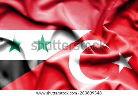 Waving flag of Turkey and Syria - stock photo