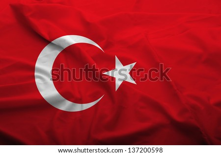 Waving flag of Turkey. Flag has real fabric texture. - stock photo