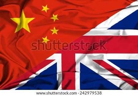 Waving flag of United Kingdon and China - stock photo