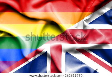Waving flag of United Kingdon and LGBT - stock photo