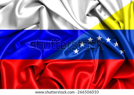Waving flag of Venezuela and Russia - stock photo