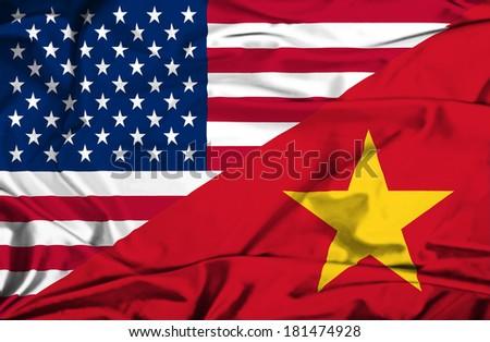 Waving flag of Vietnam and USA - stock photo