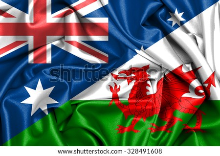 Waving flag of Wales and Australia - stock photo