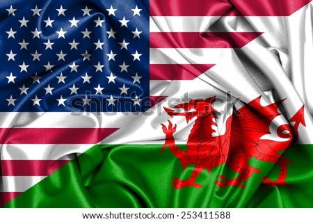 Waving flag of Wales and USA - stock photo