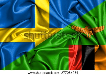 Waving flag of Zambia and Sweden - stock photo