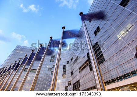 Waving flags of European Union in front of European Comission building in Brussels - stock photo