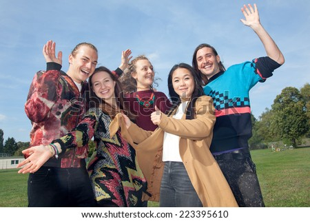 Waving group of young people