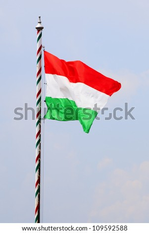 Waving Hungarian Flag Against Blue Sky - stock photo