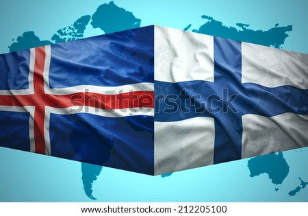 Waving Icelandic and Finnish flags of the political map of the world - stock photo