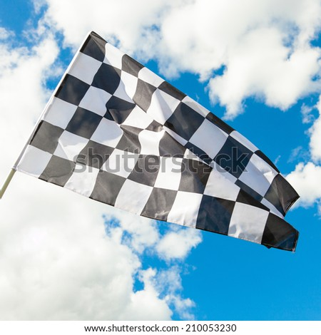 Waving in the wind race flag with blue sky and clouds on background - 1 to 1 ratio - stock photo