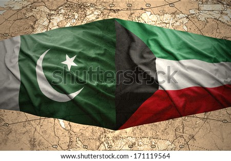 Waving Kuwait and Pakistani flags on the of the political map of the world