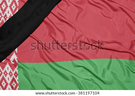 waving national flag of belarus with black mourning ribbon  - stock photo