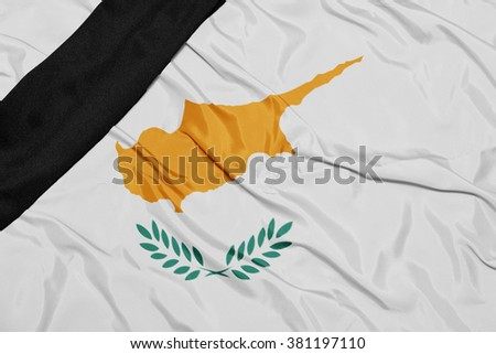 waving national flag of cyprus with black mourning ribbon  - stock photo